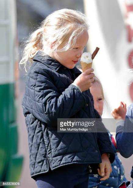 Savannah Phillips eats an ice cream as she attends the Whatley Manor Horse Trials at Gatcombe Park on September 9 2017 in Stroud England