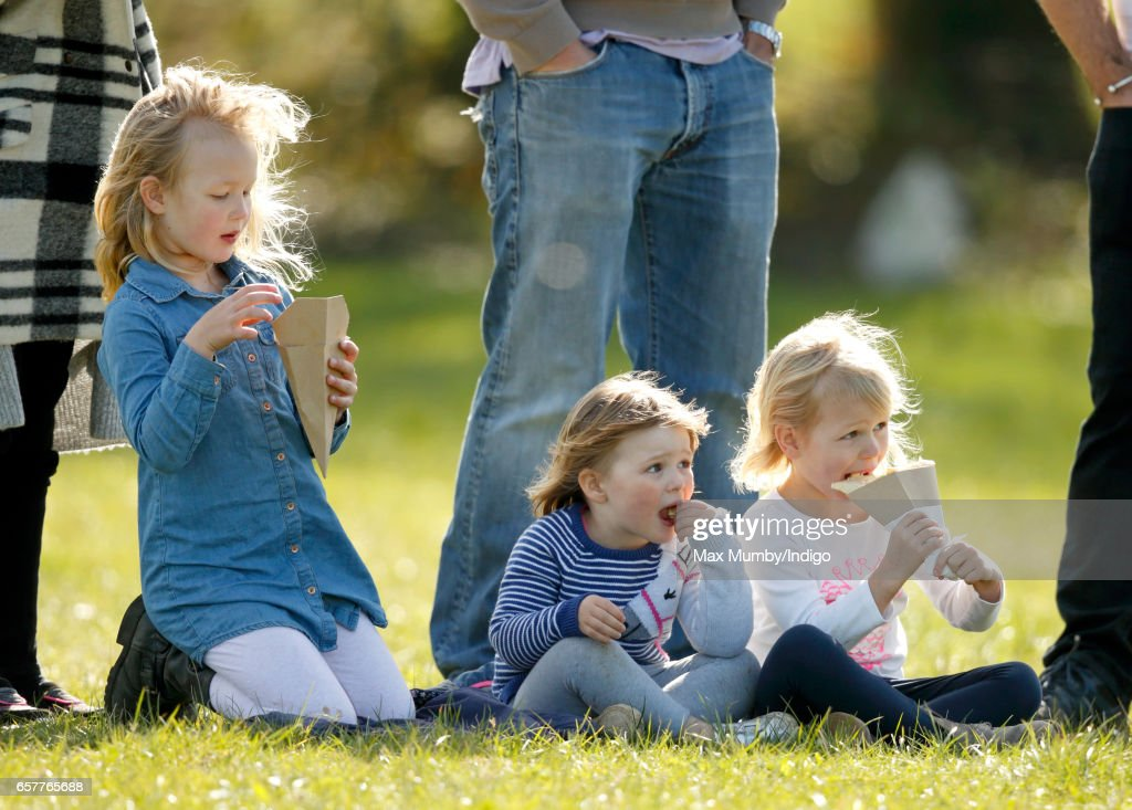 Savannah Phillips, Mia Tindall and Isla Phillips eat crepes as they attend the Gatcombe Horse Trials at Gatcombe Park on March 25, 2017 in Stroud, England.