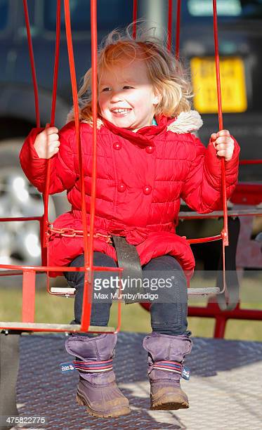 Savannah Phillips rides on a Merry Go Round Swing as she accompanied by her parents Peter and Autumn Phillips attends The Duke of Beaufort's Hunt...