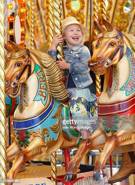 Savannah Phillips rides on a merrygoround as she attends day 4 of the Royal Windsor Horse Show in Home Park on May 16 2015 in Windsor England