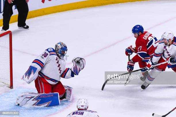 Save by New York Rangers goalie Henrik Lundqvist without his stick from a shot of Montreal Canadiens center Alex Galchenyuk during game 2 of the...