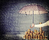 umbrella protect euro coin from rain