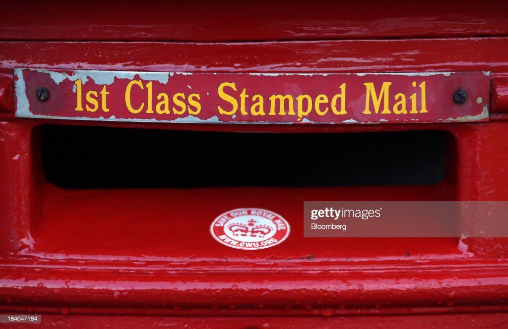 A 'Save Our Royal Mail' sticker sits on a Royal Mail Group Ltd. first class mail box at the company's postal sorting office in Romford, U.K., on Friday, Oct. 11, 2013. Royal Mail Group Ltd., Britain's 360-year-old postal service, jumped as much as 38 percent on its trading debut, heightening criticism of an initial public offering that opposition politicians say was underpriced. Photographer: Chris Ratcliffe/Bloomberg via Getty Images