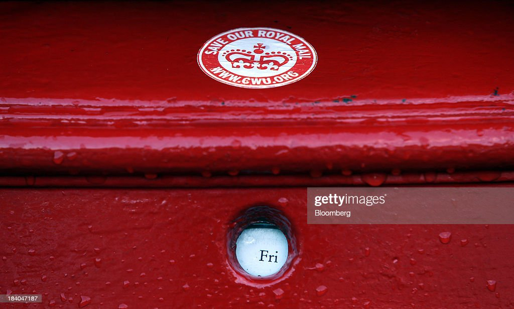 A 'Save Our Royal Mail' sticker sits on a Royal Mail Group Ltd. mail box at the company's postal sorting office in Romford, U.K., on Friday, Oct. 11, 2013. Royal Mail Group Ltd., Britain's 360-year-old postal service, jumped as much as 38 percent on its trading debut, heightening criticism of an initial public offering that opposition politicians say was underpriced. Photographer: Chris Ratcliffe/Bloomberg via Getty Images