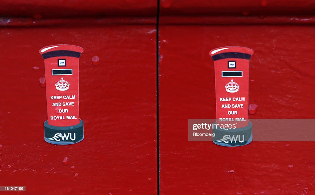 'Save Our Royal Mail' stickers sit on a Royal Mail Group Ltd. mail box at the company's postal sorting office in Romford, U.K., on Friday, Oct. 11, 2013. Royal Mail Group Ltd., Britain's 360-year-old postal service, jumped as much as 38 percent on its trading debut, heightening criticism of an initial public offering that opposition politicians say was underpriced. Photographer: Chris Ratcliffe/Bloomberg via Getty Images