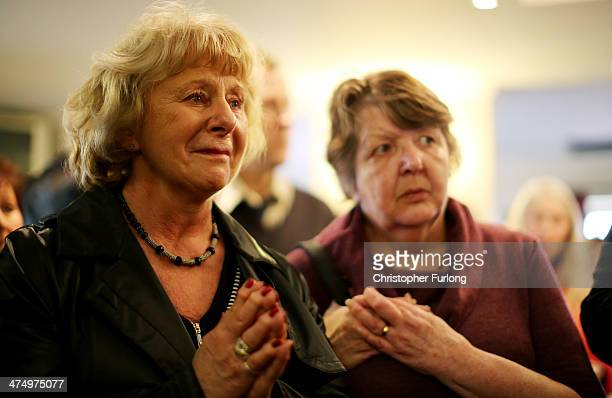 Save Stafford Hospital campaigners Ann Edgeller and Chris Baron react as a statement on the future of Stafford Hospital is read out on February 26...