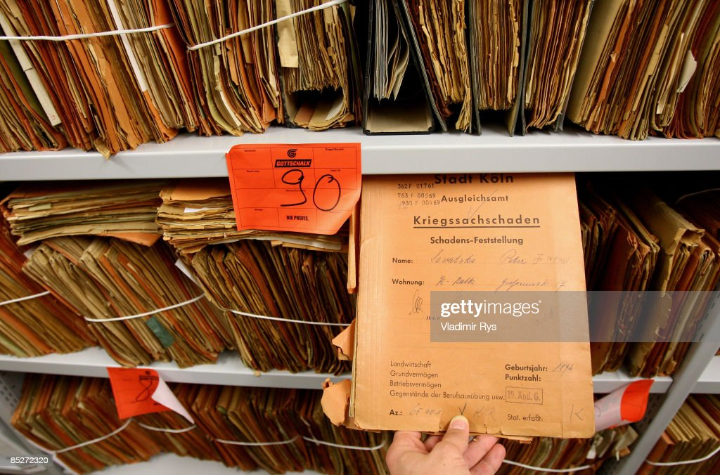 Saved documents from the Historical Archive of the city of Cologne, which were recently stored at the opposite building of the Friedrich-Wilhelm-Gymnasium are seen at the 'Ore Diocese Historical Archive' on March 6, 2009 in Cologne, Germany. Cologne's six-story city archive building groaned then collapsed in a pile of rubble Tuesday earlier this week as people inside fled in panic. The archive building collapsed about 2 p.m., ripping open and dragging down parts of two adjacent buildings that contained apartments and an amusement arcade. Two people are still missing. Unofficial voices make responsible the works in process on a new underground 'Nord-Sued' line which is passing by right under the collapsed building. Cologne has archive material going back over centuries, including manuscripts by communist pioneers Karl Marx and Friedrich Engels and documents related to German writer Heinrich Boell.