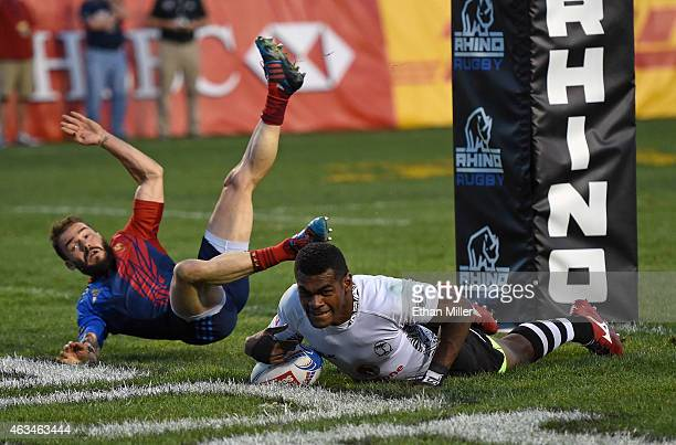 Savenaca Rawaca of Fiji scores a try against Terry Bouhraoua of France during the USA Sevens Rugby tournament at Sam Boyd Stadium on February 14 2015...