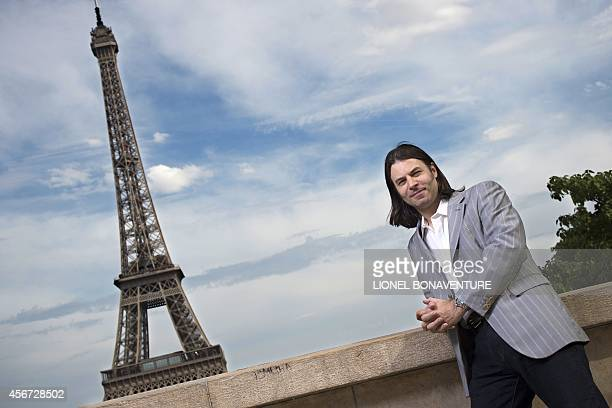 Savin YeatmanEiffel a descendant of Gustave Eiffel poses in front of the Eiffel Tower in Paris on June 23 2014 AFP PHOTO LIONEL BONAVENTURE...
