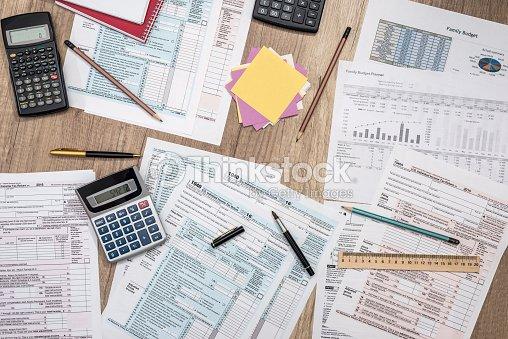 saving concept tax form budget notepad pen calculator stock photo