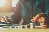 Saving money woman hand putting coin stack concept business finance