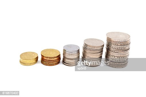 Savings, increasing columns of coins isolated on white background : Stock Photo