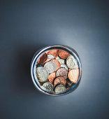 Savings jar filled with cash