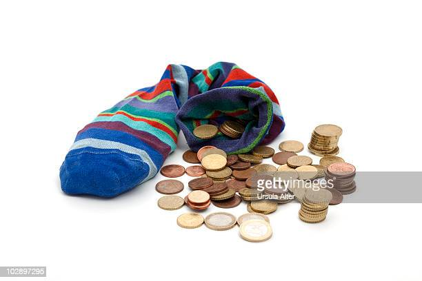 savings sock with euro coins