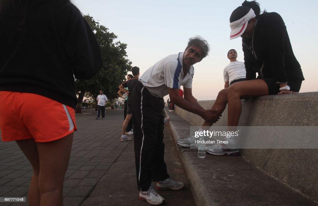 Savio who is coaching marathon runners, training an aspirant on Marine Drive on Monday evening.
