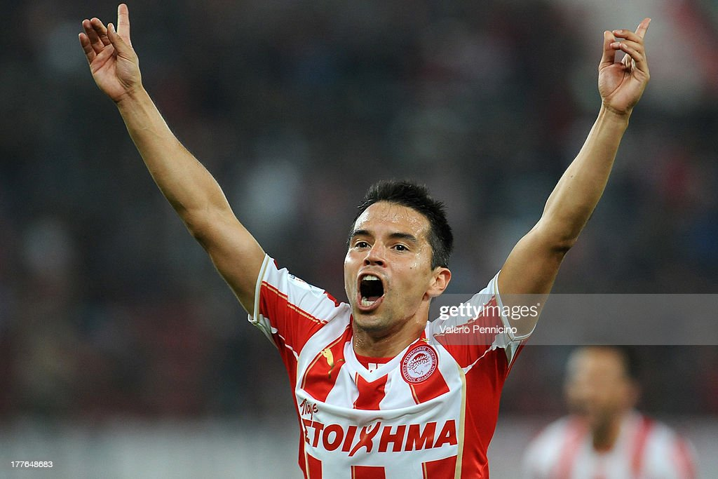 Saviola of Olympiacos FC celebrates a goal during the greek Super League match between Olympiacos FC and Atromitos FC at Karaiskakis Stadium on August 25, 2013 in Piraeus, Greece.