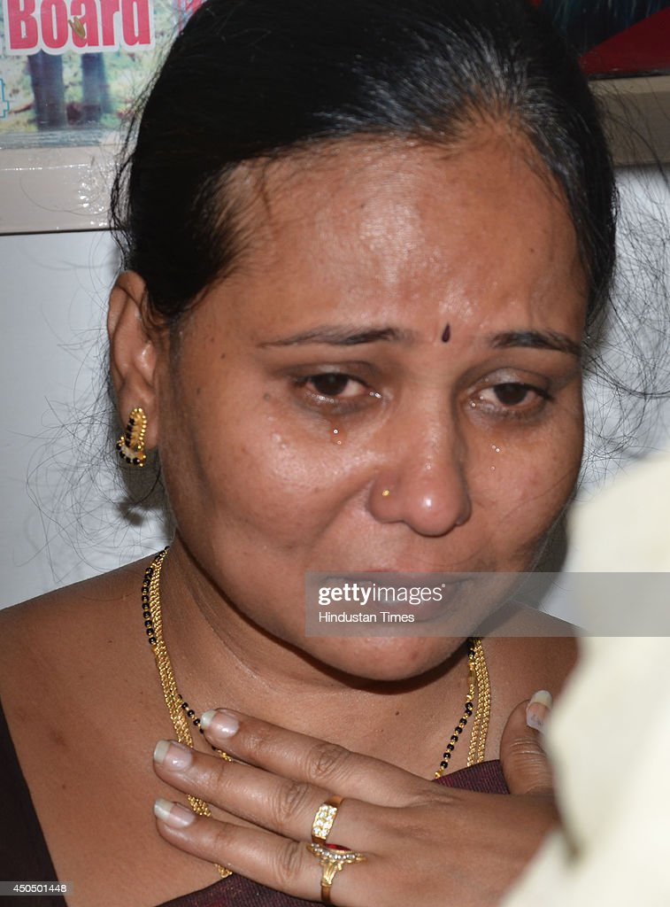 Savita, mother of Akhil who was victim of Beas river tragedy on June 12, 2014 in Mandi, India. Two more bodies were recovered from the river. A wall of water washed away 24 engineering students and a tour operator Sunday evening after water was released into the river allegedly without a warning from a nearby Pandoh Dam on Beas River.