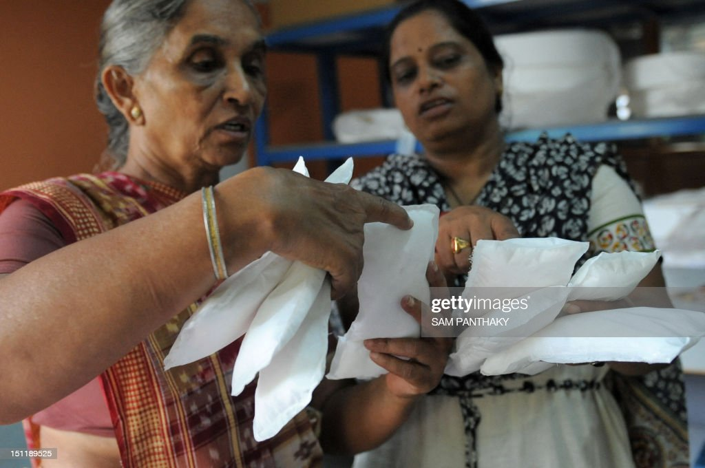 Savitaben Patel CEO of Self Employed Women's Association and Assistant Project Manager Nilam Solanki check the quality of low cost sanitary pads made...