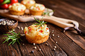 Savory Feta cheese muffins with curd, red bell pepper and herbs