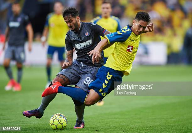 Savvas Gentzoglou of Hajduk Split and Svenn Crone of Brondby IF compete for the ball during the UEFA Europa League Qual match between Brondby IF and...