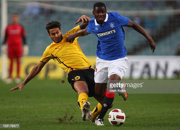 Savvas Gentzoglu of Athens tackles Maurice Edu of Rangers during the preseason friendly match between AEK Athens FC and Glasgow Rangers at the Sydney...