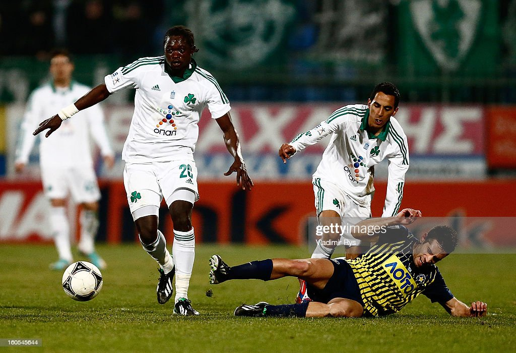 Savvas Tsampouris of Tripolis slides in as Pape Habib Sow (L) and Toche of Panathinaikos attack during the Superleague match between Asteras Tripolis and Panathinaikos FC at Asteras Tripolis Stadium on February 2, 2013 in Tripolis, Greece.