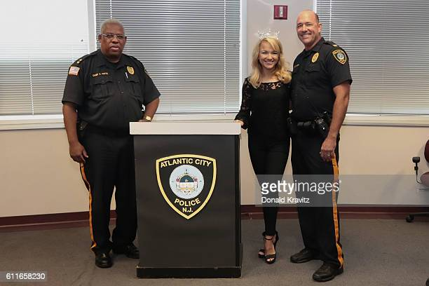 Savvy Shields Miss America 2017 poses with Henry M White Jr Chief of Police and Chris Kammerman Captain of the Atlantic City Police Department for...