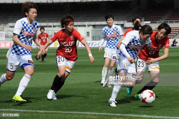 Sawako Yasumoto of Mynavi Vegalta Sendai Ladies and Aoi Kizaki of Urawa Red Diamonds Ladies compete for the ball during the Nadeshiko League match...
