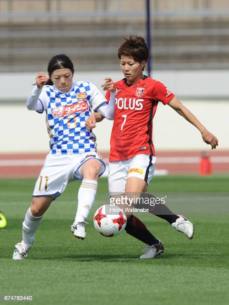 Sawako Yasumoto of Mynavi Vegalta Sendai Ladies and Risa Ikadai of Urawa Red Diamonds Ladies compete for the ball during the Nadeshiko League match...