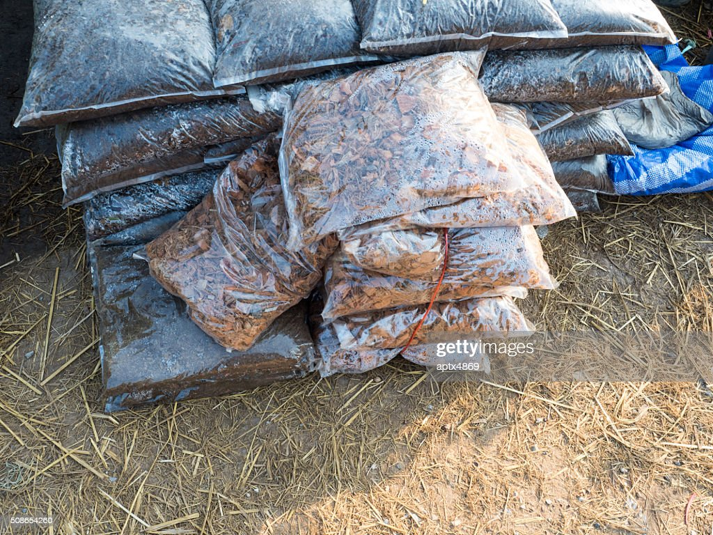 Sawdust and fertilizer in the plastic bags : Stock Photo