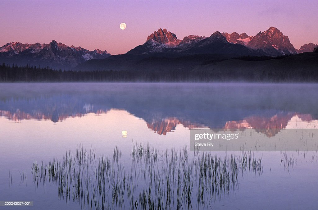 Sawtooth Mountains reflecting in Little Red Fish Lake, sunrise