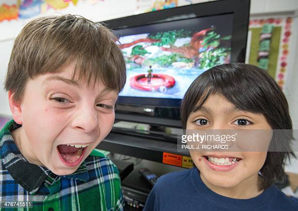 Sawyer Whitely 10yrs and Michael Mendoza 10yrs who are autistic pose for a photo while playing selected games on a Microsoft Xbox Kinect February 21...