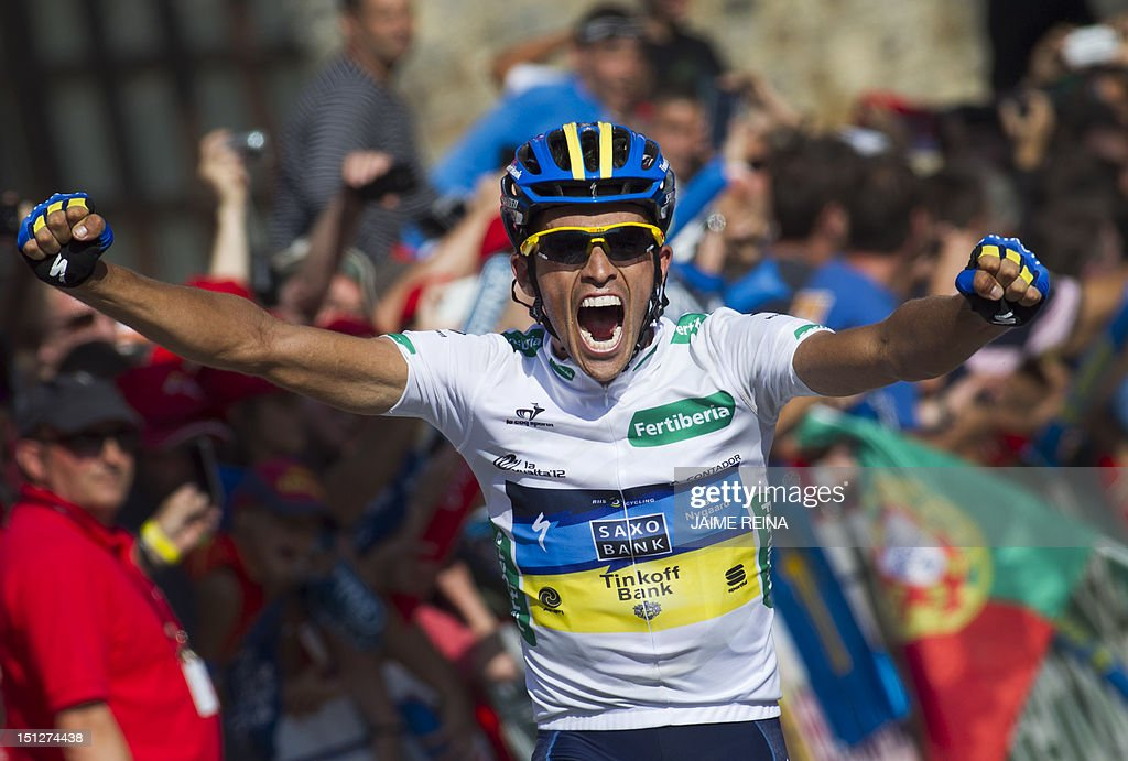 Saxo Bank-Tinkoff Bank Team Spanish cyclist Alberto Contador celebrates as he wins the 17th stage of the Vuelta tour of Spain cycling race, a 187,3 kms ride from Santander to Fuente De, on September 5, 2012. AFP PHOTO/ Jaime REINA