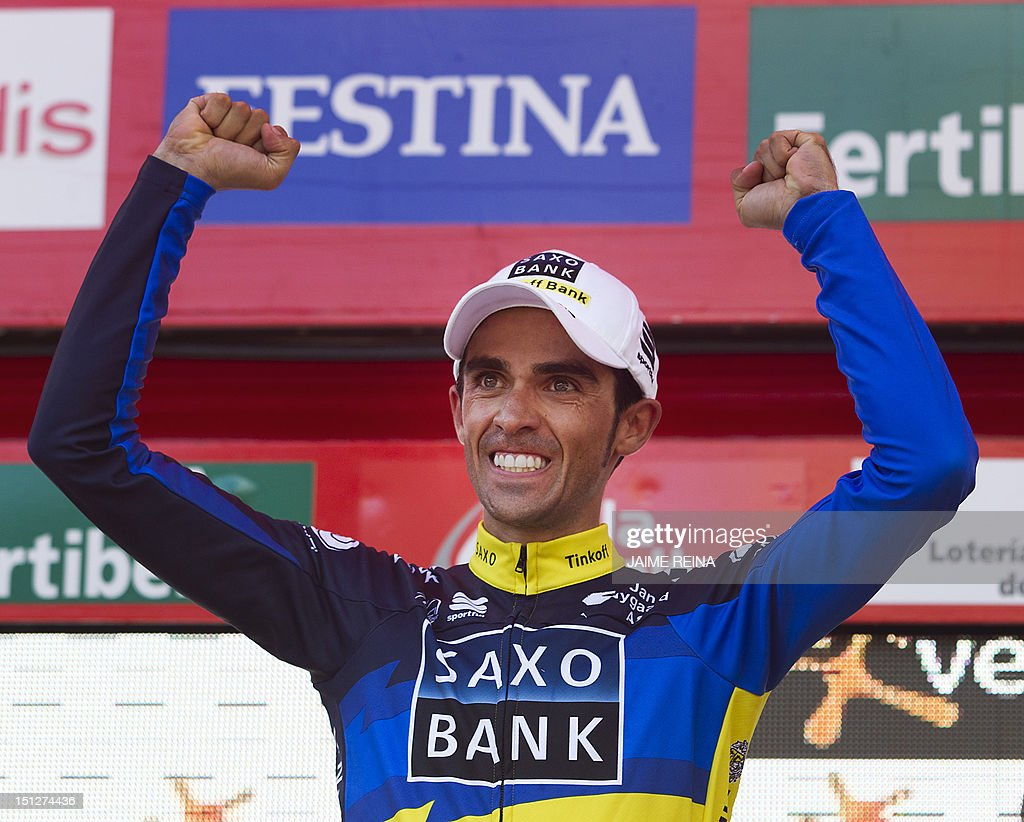 Saxo Bank-Tinkoff Bank Team Spanish cyclist Alberto Contador celebrates on the podium after winning the 17th stage of the Vuelta tour of Spain cycling race, a 187,3 kms ride from Santander to Fuente De, on September 5, 2012. AFP PHOTO/ Jaime REINA