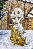Saxon Gravestone in the snow covered  Bishops Caundel churchyard, UK