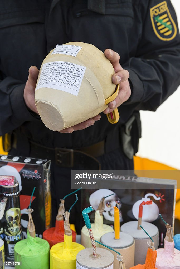 Saxony state police demonstrate illegal fireworks during a presentation to the media on December 27, 2012 in Dresden, Germany. The legalized sale of fireworks to welcome in the New Year begins nationwide in Germany on December 28 and police are warning of the danger of certain types of fireworks imported illegally from countries like Poland and the Czech Republic.