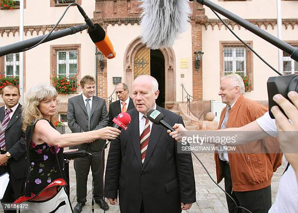 Saxony's State Premier Georg Milbradt gives a statement 20 August 2007 at the market square in Muegeln eastern Germany German police said they...