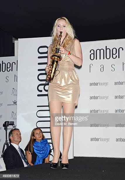 A saxophone player walks the runway at the Amber Lounge 2014 Gala at Le Meridien Beach Plaza Hotel on May 23 2014 in Monaco Monaco