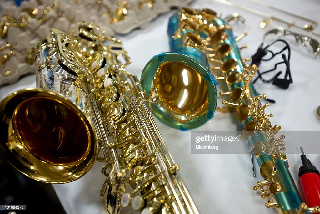 Saxophones sit on a work bench in the manufacturing department of the E.K Blessing Co. in Elkhart, Indiana, U.S., on Thursday, Feb. 7, 2013. Photographer: Ty Wright/Bloomberg via Getty Images