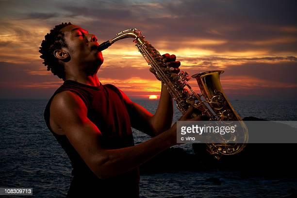Saxophonist at sunset