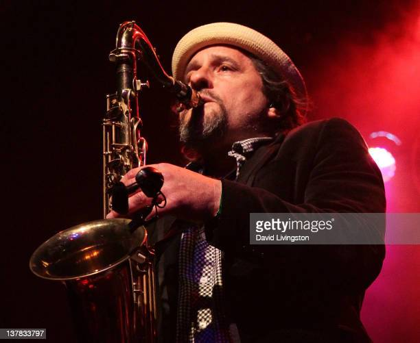 Saxophonist David Ralicke of Dengue Fever performs on stage at the El Rey Theatre on January 27 2012 in Los Angeles California