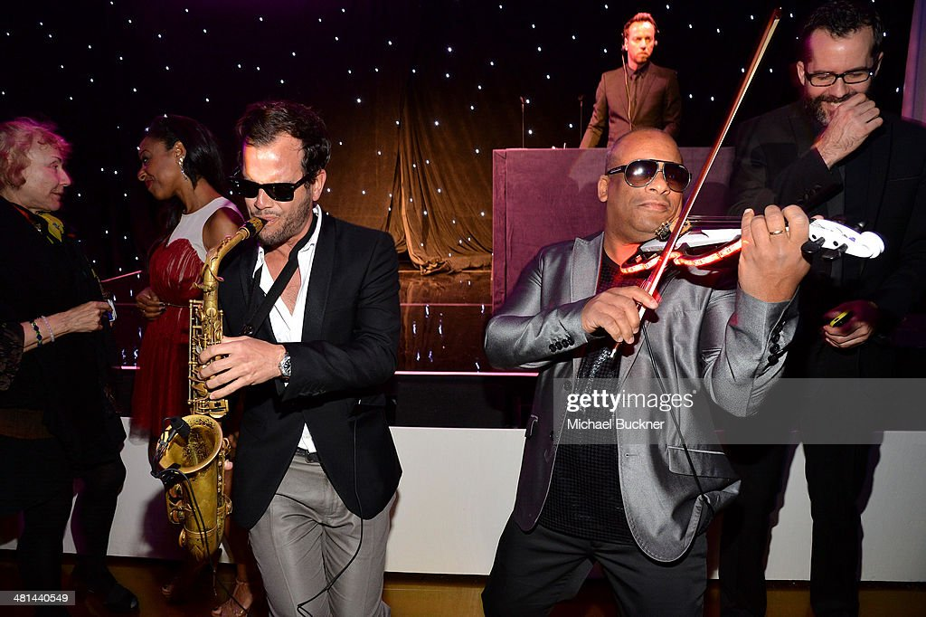 Saxophonist Florencio Cruz, violinist Julio Cuba, and DJ Philippe Paris perform onstage MOCA's 35th Anniversary Gala presented by Louis Vuitton at The Geffen Contemporary at MOCA on March 29, 2014 in Los Angeles, California.