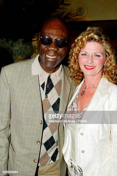Saxophonist Manu Dibango and singer and actress Jeane Manson attend the Bordeaux wine presentation at Pavillon Gabriel in Paris