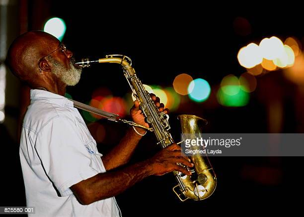 Saxophonist on street at night, New Orleans, Louisiana, USA