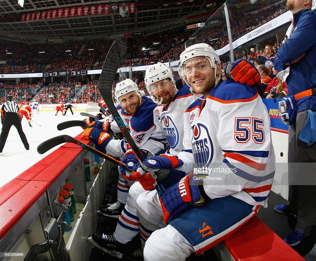 Say Cheese! Mark Letestu #55, Matt Hendricks #23 and Zack Kassian #44 of the Edmonton Oilers are all smiles on the bench against the Calgary Flames at Scotiabank Saddledome on January 21, 2017 in Calgary, Alberta, Canada.