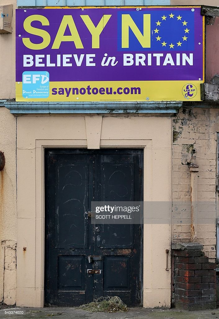 A 'Say No Believe in Britain' board is displayed on a building in Redcar, north east England on June 27, 2016 Thursday's dramatic vote to quit the European Union was driven by millions of people in the post-industrial north and centre of England, in working-class towns like Redcar, on the northeast coast. The strength of feeling may have stunned metropolitan Britain, but came as no surprise in places like Redcar, where 66.2 percent ultimately voted to leave the EU. / AFP / Scott Heppell / TO