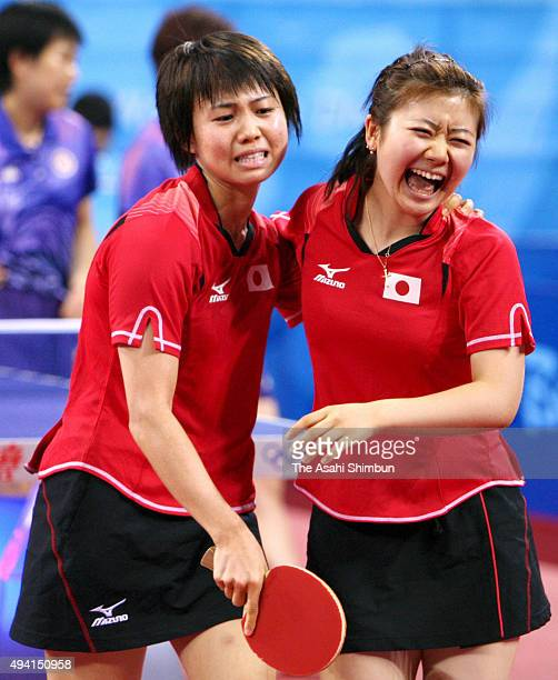 Sayaka Hirano and Ai Fukuhara of Japan celebrate winning their match of the Women's Team Bronze medal playoff second round against Hong Kong at the...