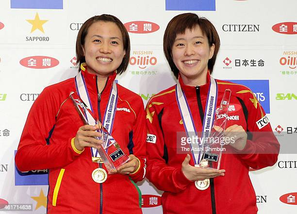 Sayaka Hirano and Kasumi Ishikawa pose for photographs during the victory ceremony for the Women's Doubles during day six of the All Japan Table...
