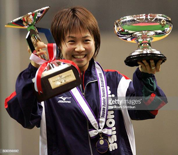 Sayaka Hirano celebrates at the award ceremony after winning the Women's Singles final against Asami Suemasu during day six of the All Japan Table...
