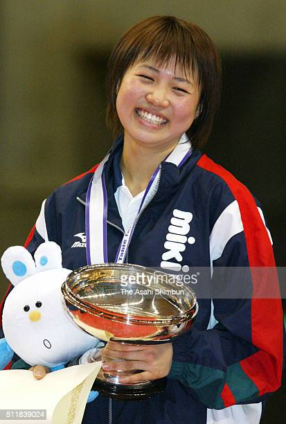 Sayaka Hirano celebrates with the trophy after winning the Women's Singles during day four of the All Japan Table Tennis Championships at the Tokyo...